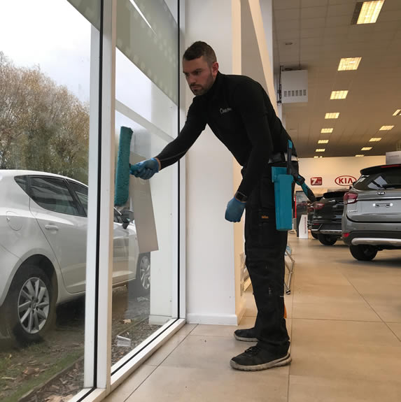 Andy cleaning a window